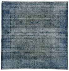 distressed overdyed blue persian rug with modern industrial style overdyed vintage rugs