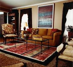 living room rectangle table wingback chairs white fireplace tile blue rug window glass living room decorating
