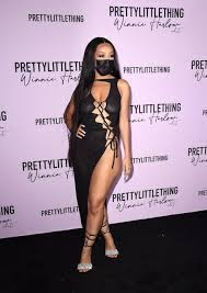 Doja Cat Went Braless in a Lace-Up ...