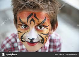 cute little boy aqua makeup tiger muzzle stock photo