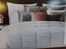 all white cotton duvet set from nicole miller with lots of ruched gathers and pintuck detailing with decorative bands of metallic silver threads unique