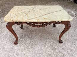 coffee table in carved wood and marble