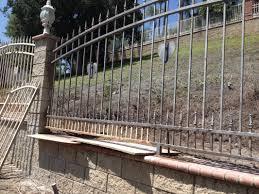 blasted wrought iron fence
