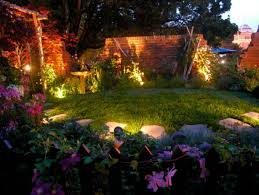 Small garden lighting ideas Patio Awesome Backyard Lighting Ideas With Large Brick Fence And Small Canopy Also Flower Vines Plus Pinterest Lighting Ideas Awesome Backyard Lighting Ideas With Large Brick