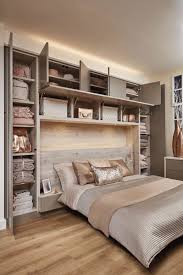 built in bedroom furniture designs. this stunning contemporary grey bedroom features headboard lighting and overhead storage built in furniture designs