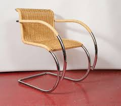 mies van der rohe style wicker and chrome arm chair at 1stdibs