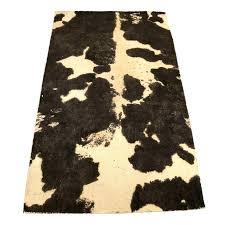 cow print area rug pottery barn wool paw uk p dog paw print table runner handcrafted locker rug aj