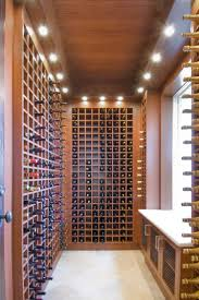 Home for sale in Fort Lauderdale with Custom refrigerated wine room with  wine racks and heavy custom mahoghany insulated glass door.