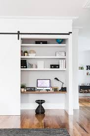 office closet shelving. this study nook is cleverly concealed behind a sliding door within living room photo office closet shelving e