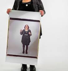 elsa dorfman with a 20 inch by 24 inch polaroid self portrait in her studio in cambridge m credit gretchen ertl for the new york times