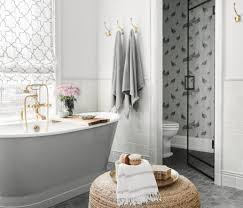 a moroccan star pattern seen in the tile floor and shower was the starting point for the soothing yet eclectic vibe of this master bath