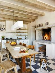 one of our fireplace remodeling ideas is to add one to your kitchen or dining space