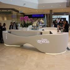 Isomi Kin reception desks offer four unique modern ergonomic designs fully  specified with sign-in desk, cable ports, pen holders and storage.