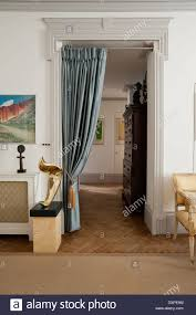 Silk Curtains For Living Room A Silk Curtain Dividing A Hallway And Living Room With Parquet