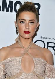 amber heard writes powerful essay about domestic abuse amber heard arrives at the glamour women of the year 2016 at neuehouse hollywood on 14 2016 in los angeles california