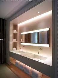 cove lighting design. A Custom-built Wall-mounted Vanity Unit With Cove Lighting, Shelf Niches And Long Expanse Of Poured Sink Counter Offers Boutique Hotel Feel At Home. Lighting Design