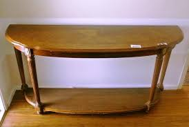 image of small half circle console table