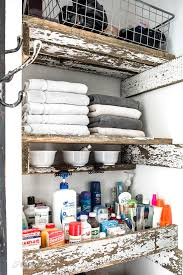how to build unique reclaimed wood closet shelves in a bathroom includes shallow shelves and