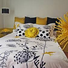 feminim white duvet covers with black plant sketch combined with black yellow pillows 14444 beautiful