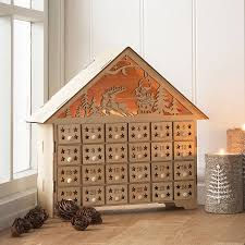 gisela graham wooden fretwork light up advent calendar house a great range of advent calendars gifts and homewares from the contemporary home