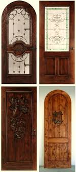 custom wine cellar wood doors also with glass and wrought iron features
