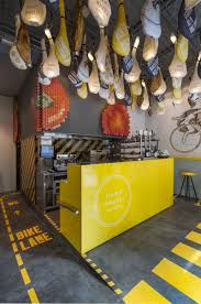 Yellow Kitchen Theme Modern Fast Food Restaurant Interior Design Idea With Bicycle