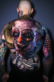 Terrifying Clown Tattoo Comes To Life When Man Moves His Back Muscles