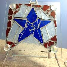 large piece of glass colored pieces broken colored glass pieces