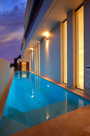 residential indoor lap pool. Pool Design: Private Residential Lap Design With Ceramic Side Flooring And Smar Landscape Utilization Indoor