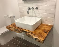 Which meant i was going to have to diy my own, despite adam's misgivings about having a sink made out of wood (for obvious reasons.) Live Edge Slab Natural Edge Slab Wood Counter Top Bathroom Vanity Vanity Top Bar Top Restaurant Tables Wood Slab Natural Wood Wood Slab Floating Shelves Bathroom Rustic Vanity Vanity Shelves