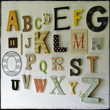 the gigi alphabet is a beautiful collection of wooden letters  on wall art letters wood with alphabet wall www littlestarblog