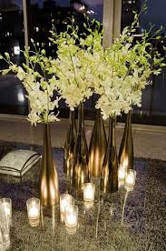 metallic wine bottles and white flowers for an elegant centerpiece