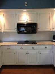 Tile Under Kitchen Cabinets To Ceiling Or Counter To Ceiling Subway Tiles A Subway Tile Wall