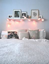Bedroom Shelf With Leaning Framed Photos And String Lights