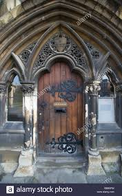 Medieval Doors church house with a medieval door with wrought iron hinges 5990 by xevi.us
