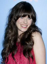 zooey deschanel long curly hairstyle with bangs