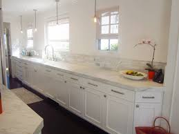 one wall galley kitchen design. white flat cabinets single wall long galley kitchen design in one side for chic look