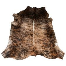 cowhide rugs tricolour cream and black caramel ni rugs ethical