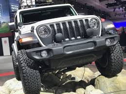 the black fuel door new from mopar has been redesigned to incorporate styling cues of the all new wrangler mopar doorsill guards grab handles and