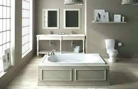 small clawfoot bathtub bathroom with corner shower