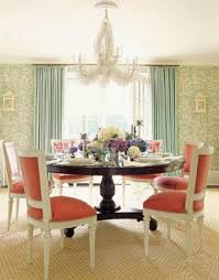 elegance dining room with wooden round table pink chairs green wall