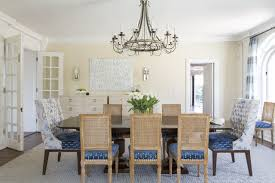 the dining room is a mix of modern and traditional style with artwork by antoine