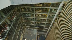 contemporary office building. 4k / Ultra HD Version Interior View Of A Large Contemporary Office Building With Glass Partitions And Central Atrium. No People.