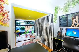 studio office design. Studio Office Design Yellow Infuses Electric Charm To This Snazzy Home Game