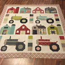 And the second one. Bad lighting, but it's ready for some quilting ... & I designed the layout myself, but I used book Vintage Farm Girl patterns  for the blocks. I had to resize the red barns with the white windows from  12 to 14 ... Adamdwight.com