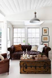 dark brown leather couch with vintage trunk table