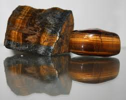 tiger s eye a polished reddish brown stone which is bisected by a band containing golden fibers