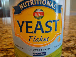 nutritional yeast nooch info 11 recipes kale chips pb cups dips dressings toppings mac n cheeze cheezy nut pates