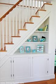 For under the stairs in our hallway, perhaps there could be some shoe  organization in the cupboard too. wood bannister rail, painted balustrades,  ...