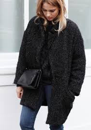 mirjam flatau is wearing a heavy winter coat this is the delphe wool coat from